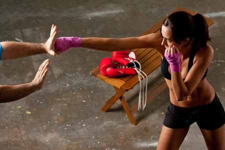 woman boxing gloves: Girl training body combat Stock Photo