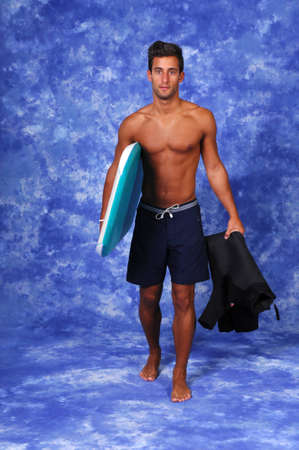 Attractive young man with a boogie board  studio photo  photo