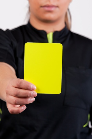 female referee showing the yellow card photo