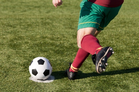 a soccer player ready to score a penalty
