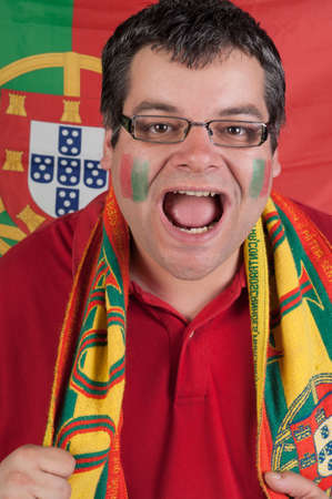 Portugal soccer fan with the portuguese flag as background Stock Photo - 13892733