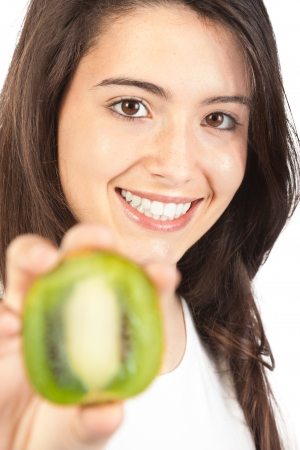 Young woman holding a kiwi photo