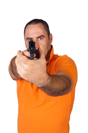 man with a gun ready to shoot (focus on the weapon) photo
