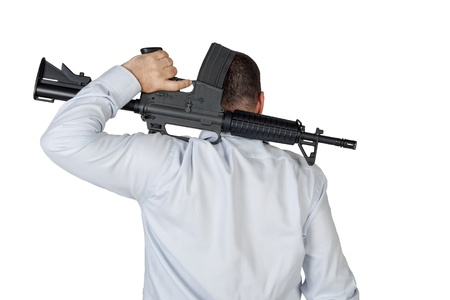 Man with a gun ready to shoot  photo