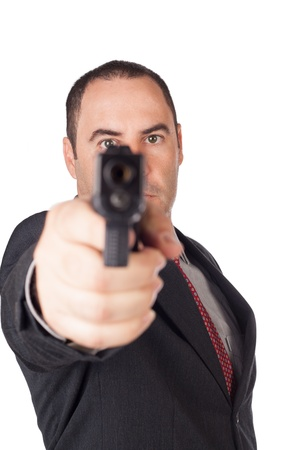 Man with a gun ready to shoot  focus on the weapon
