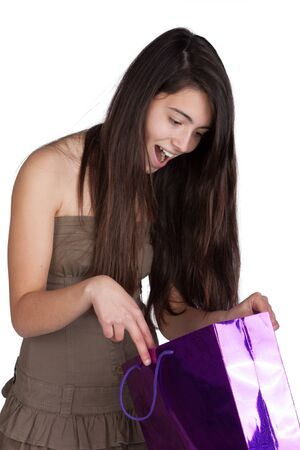 Happy young girl shopping  on white background