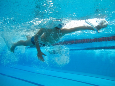 swimmer in comptition, swimming underwater photo  Stock Photo