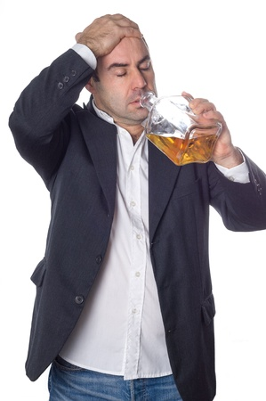 man drunk drinking from a bottle of whisky over white background Stock Photo