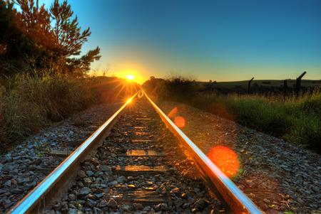 Sunset on train rail.