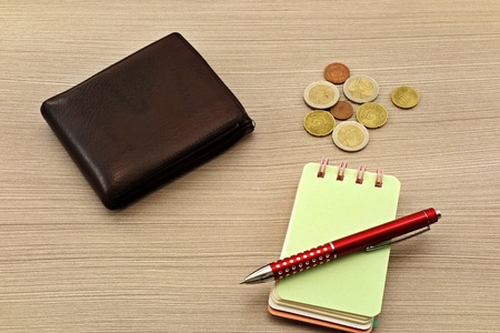 Euro bills, notebook and pen on the table Reklamní fotografie