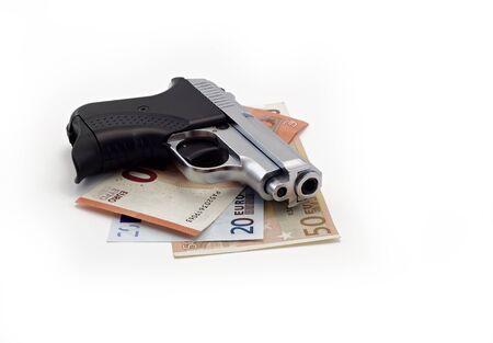 gun and euro banknotes on a white background Stock Photo