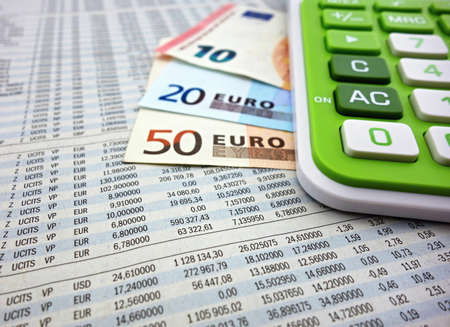 account executive: Euro banknotes and calculator on the stock numbers