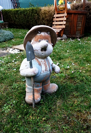 lawn gnome: garden gnome with a shovel on grass Stock Photo