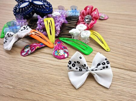 hairpin: various hair accessories for young girls on wooden floor