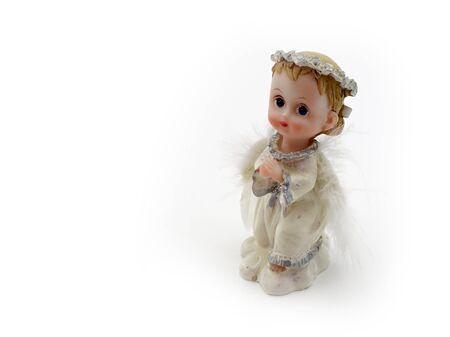 praying angel: kneeling, praying angel on a white background Stock Photo