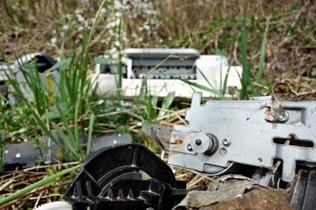 free standing: discarded electronic appliances free standing in nature