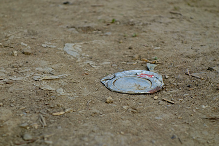 crushed cans: compressed drinks canister of a beverage dirt road Stock Photo