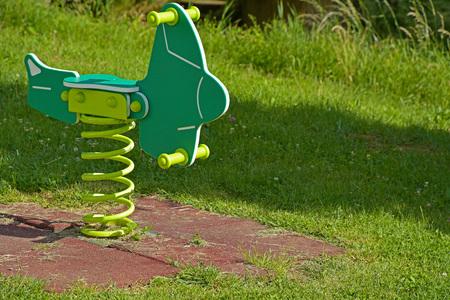 Childs rocking horse on green grass