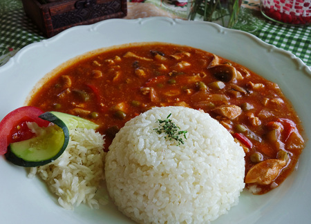 Spicy chicken slices and rice, annex, table in the restaurant