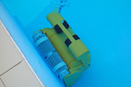 A robotic vacuum cleaner cleans the bottom of the pool
