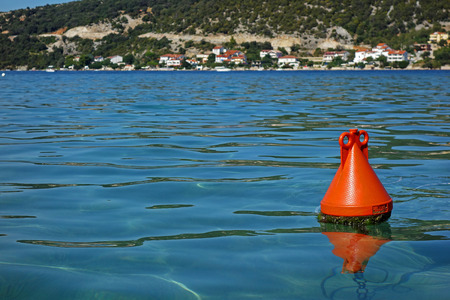 one red buoy and a sea Stock Photo