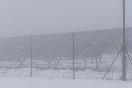 winter time and solar collectors in fog
