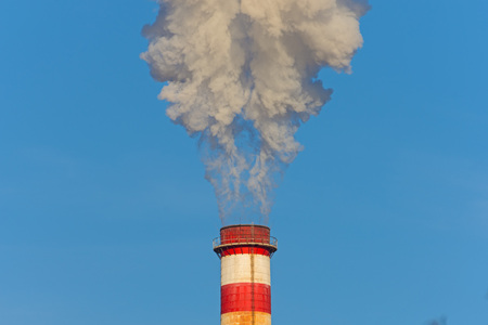 Big white smoke from the factory chimney. Stock Photo