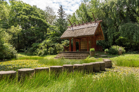 Shelter, wooden gazebo in the park and green grass Stock Photo