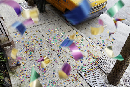 Confetti falling on the pavement from a giants perspective Stock Photo