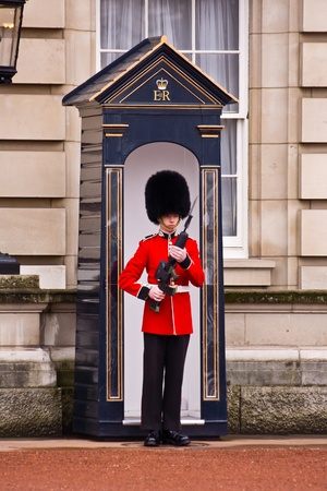 buckingham: LONDON - OCTOBER 15: Sentry of the Grenadier Guards posted outside of Buckingham Palace on October 15, 2010 in London U.K..
