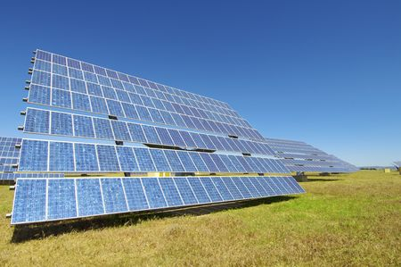 Solar field with blue sky photo