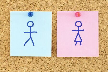 inequality: blue and pink paper in a corkboard Stock Photo