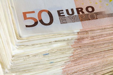 euro banknotes: pile of fifty Euro banknotes
