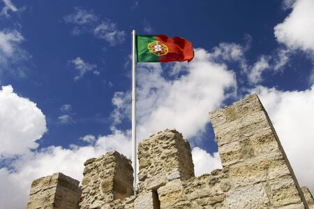 portugal flag on a mast located on a tower of the castle of St. George; Lisbon photo