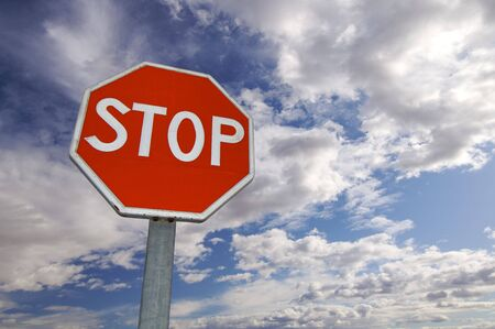 signal stop: stop signal with cloudy sky