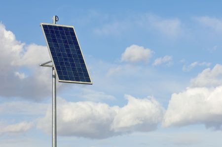 little photovoltaic panel with cloudy sky Stock Photo - 5902539