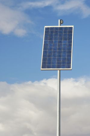little photovoltaic panel with cloudy sky photo