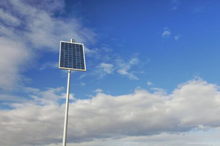 little photovoltaic panel with cloudy sky Stock Photo - 5902545