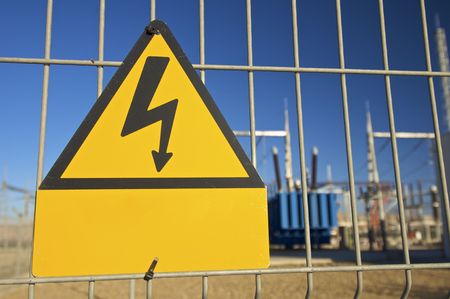 Warning sign high voltage with blue sky Stock Photo - 5920813