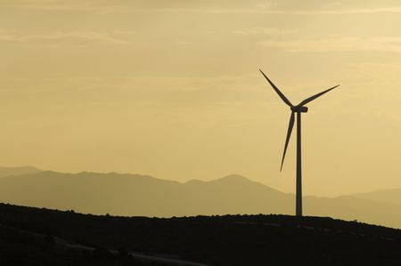 Wind power aerogenerator skyline at dusk; Fuendetodos; Spain photo