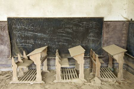schoolhouse: abandoned desks in a old school Stock Photo