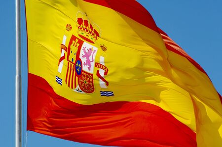 Spanish constitutional flag waving in the wind photo