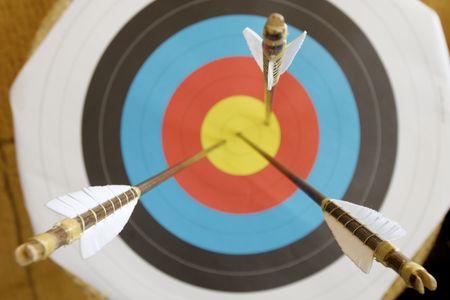 marksmanship: three arrows in the center of a dartboard