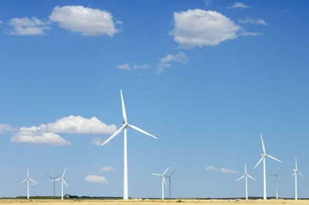 windmills against blue sky with clouds photo