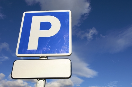 parking signal with cloudy sky Stock Photo