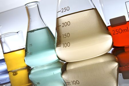 several glassware with color liquid photo