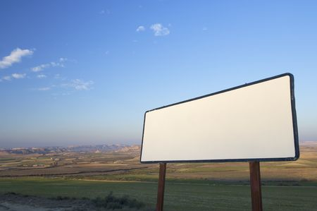 blank sign located in a flat landscape photo