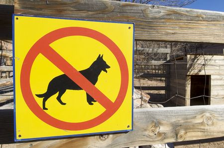 no dogs signal in a wood fence photo