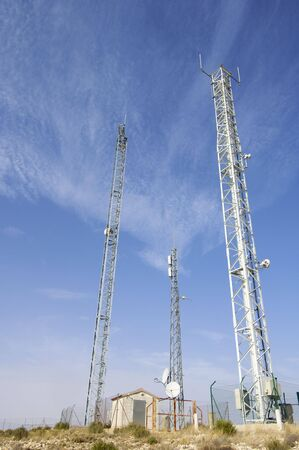 telecommunications towesr and blue sky photo