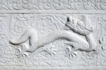 carved dragon in a chinese wall photo